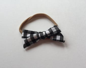 White and black checkered bow
