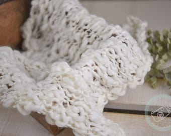 Cream hand knitted layer for newborn photography. Thick and thin yarn for added taxture. Baby photo prop.