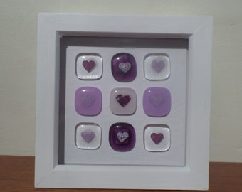 Hand crafted framed love hearts made of fused glass in a range of colours  lilac and pink