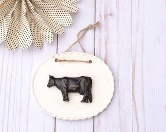 Ceramic Cow Sign. Black Cow.