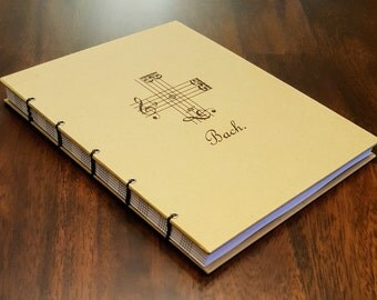 Bach Signature Music Journal: Handmade Coptic-Bound Notebook with Bach's Musical Signature on the cover and your choice of paper.