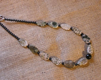Black and gray ocean jasper necklace.  It may encourage patience.