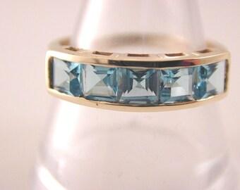 Blue Topaz Five stone half eternity ring 1994. 2.85 carats. 2.2 grams size P 1/2