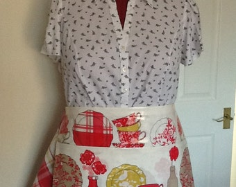 Oilcloth apron with handcloth