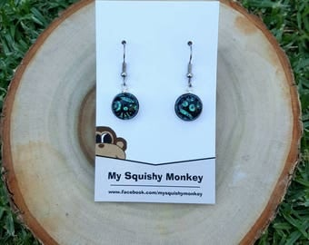 Green and black dichroic glass dangle earrings