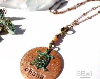 ohana necklace with verdigris turtle detail