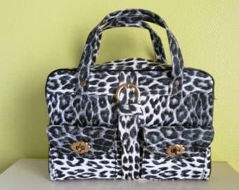 Fantastic black and white leopard vinyl 60s handbag .
