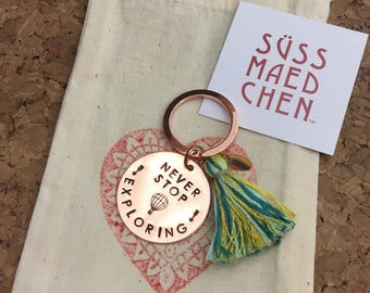NEVER STOP EXPLORING hand stamped Keychain or good luck charm