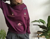 Floral hand embroidery on organic cotton sweatshirt