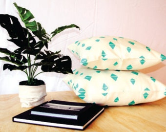 White and teal triangles. Modern geometric cushion cover. Perfect for any space. Two sizes available