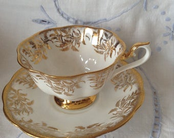 Royal Albert gold on white teacup and saucer