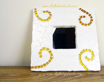 Mirror with mosaic-tiled