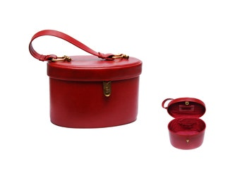 Vintage vanity train case, oval wine red leather imitation cosmetic bag with top handle, brass clasp and mirror, 1960s make up accessory