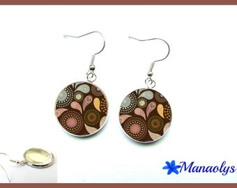 Earrings of pink, blue and yellow patterns on Brown background, 2102 glass cabochons