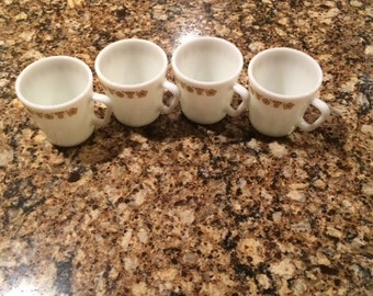 Set of four Pyrex Corelle Butterfly pattern coffee cups