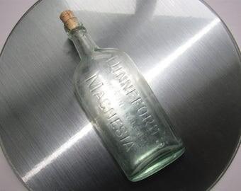 Vintage Magnesia bottle. Dinneford's Magnesia bottle. Made in England bottle. 1940s 1930s apothecary bottle. Corked bottle. Aqua green glass