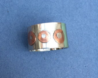 Handmade rivet ring, Sterling silver riveted ring. With copper accents Size P UK, size US. riveted copper and silver ring
