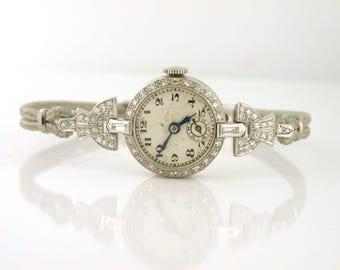 1940's Platinum and Diamond Watch 17 Jewels. Swiss, Elegant Watch Co. Cord band. Safety clasp WAT10057