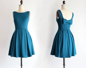 JANUARY | Teal bridesmaid dress with bow. vintage inspired cocktail dress. pleated skirt party dress. retro mod bridesmaids dress
