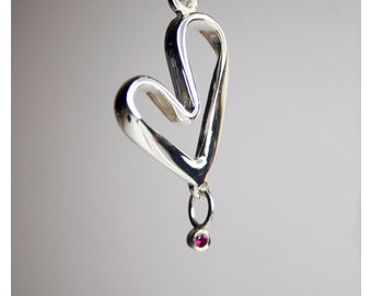 JP4. Sterling Silver Handcrafted Large Heart Pendant with a Lab Created Red Garnet Stone