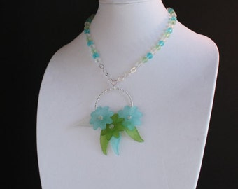 Floral Bouquet Balanced on Silver Hoop Necklace