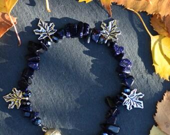 Blue Goldstone bracelet with leaf charms