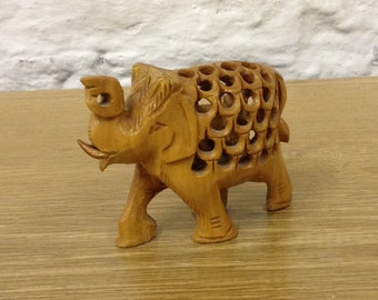 Vintage Hand Carved Wooden Elephant With Baby Elephant Inside. Great Condition.