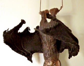 Bat on a trapeze sculpture figurine