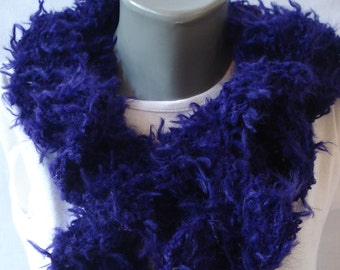 purple twisted scarf, made of fantasy yarn.