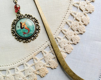 La Sirena brass book hook bookmark with dangling glass cabochon accent
