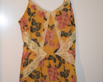 Fabulous vintage inspired Feminine Romantic strappy boho hippy dress with lace and floral printDesigned by Kimchi Blue at Urban Outfitters
