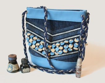 Blue pouch in fabric and embroidered leather