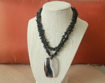 Black obsidian double-stranded necklace with a black agate and quartz focal