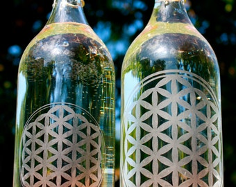 32oz. Flower of Life etched glass water bottle with swing top made by hand with intention.