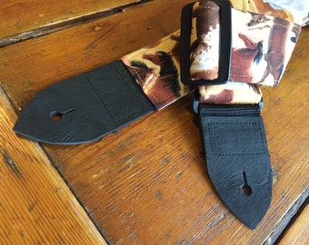 Western guitar strap -- horses roaming wild on the range -- shades of brown, black and tan