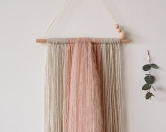 Wall weaving in pink and beige
