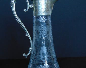 Victorian or Early Edwardian   etched and cut crystal claret jug with silver plated spout and handle mounting.
