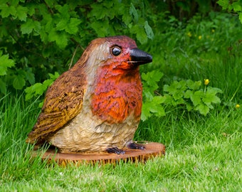 Robin chainsaw carving