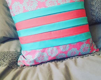 Colourful cushion, pink and blue
