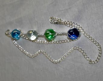 Wire wrapped charm with 4 marbles and attached chain