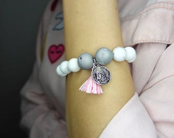 Unique Beaded Bracelet with charm, pink detail.