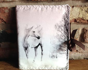 Fabric covered notebook, A5, padded and machine embroidered.  Complete with notebook.  Striking unicorn print - white, pinks & mauve.