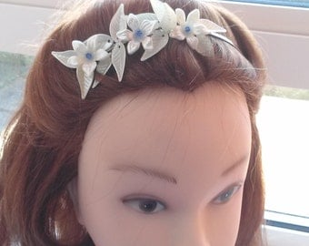 Ivory floral side tiara with ivory leaves with a hint of blue crystal