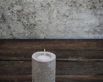 Handmade scented, soy wax candle set in concrete 'tin can'.