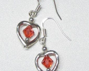 heart shaped dangle earrings with red coral swarovski crystals,coral crystal dangle earrings,heart dangle earrings,silver dangle earrings
