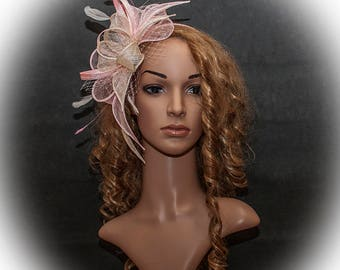 Powder pink and champagne large fascinator for your special occasions to be worn on the right side of the head.