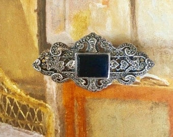 Victorian Revival Mourning Brooch Intricate Hearts Scrolls Design Beveled Onyx Sterling Silver Marcasite Openwork Frame Stunning