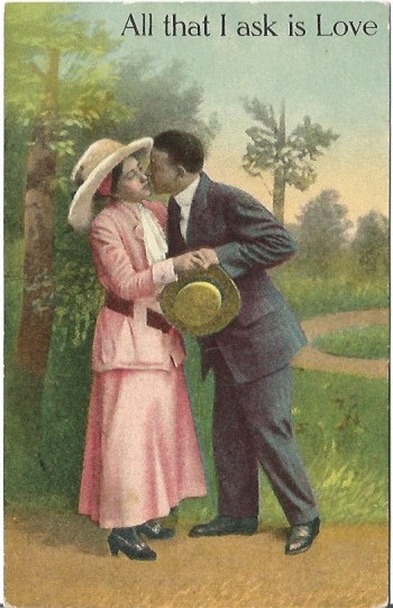 Victorian Woman dressed in Pink with Giant Hat Kissed By Gentlemen in Park Vintage Postcard