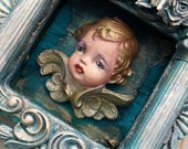 """Baby Blue Skies winged vintage painted porcelain baby cherub, columned, framed wood shrine box assemblage 6  1/2"""" x 6  1/4""""  wall hanging"""