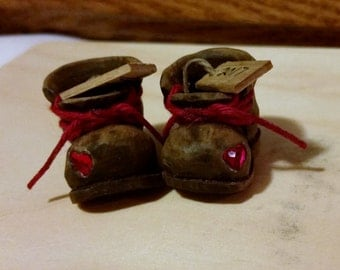 Pair of Old Boots with a red Swarovski heart inlaid in toe area.